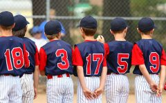 Little League players standing in line before a game.